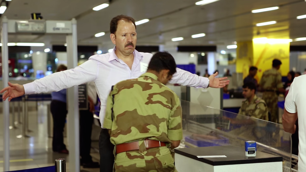A passenger is frisked by a CISF guard at Delhi airport. Credit: CISF/YouTube