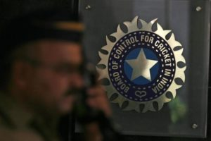 A policeman walks past a logo of the Board of Control for Cricket in India (BCCI) in Mumbai April 26, 2010. Credit: Reuters/Arko Datta/Files
