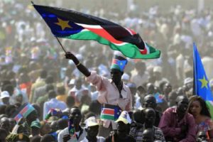 File photo of a Sudanese man waving the national flag. Credit: Reuters