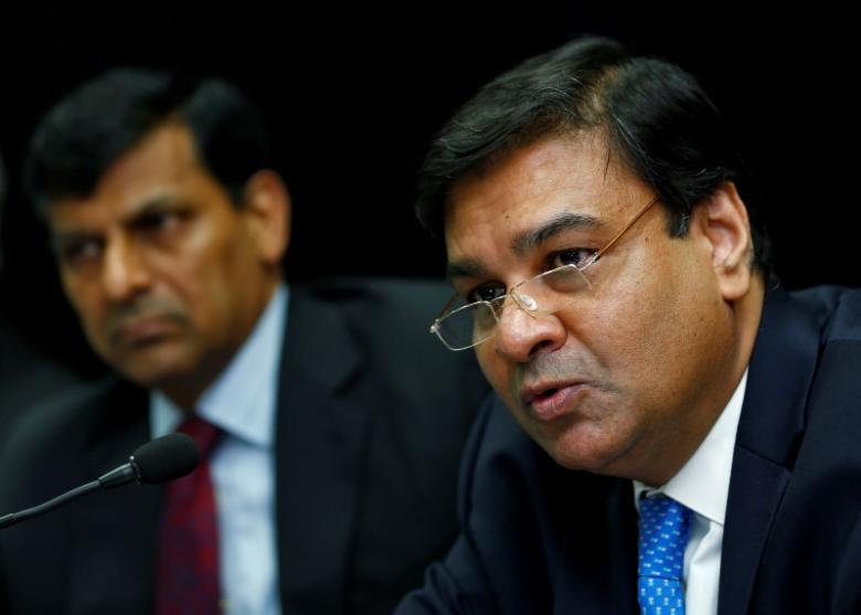 Reserve Bank of India Governor Urjit Patel with former governor Raghuram Rajan in the background. Credit: Reuters/Danish Siddiqui