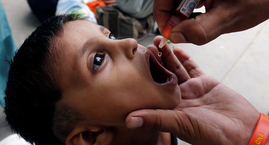 A boy in Pakistan receives oral polio vaccine in July. Credit: Reuters/Akhtar Soomro