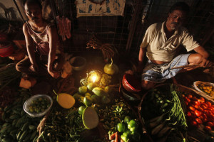 Vegetable vendors wait for customers at their stall in Kolkata July 31, 2012. Credit: Reuters/Rupak De Chowdhuri