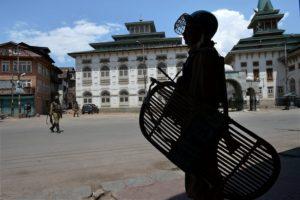 CRPF jawans stand guard during curfew and strike in Srinagar. Credit: PTI