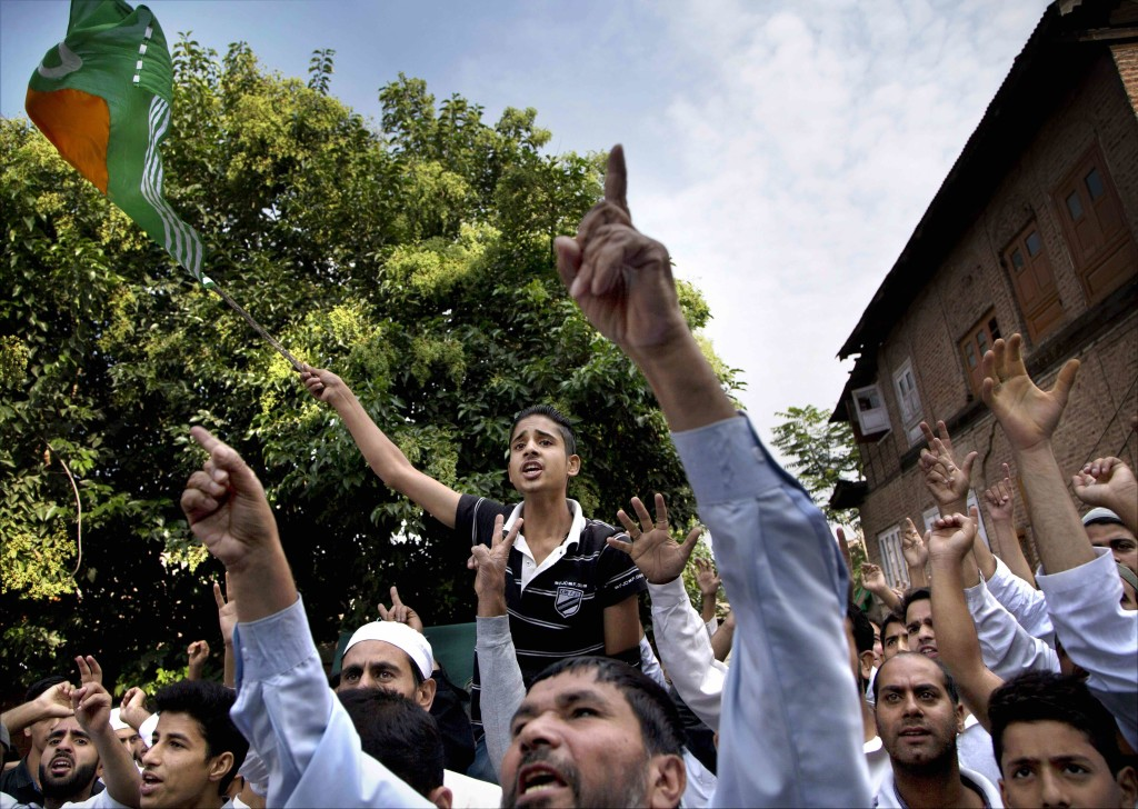 Kashmiri protesters shout freedom slogans during a protest after Eid prayers in Srinagar on Tuesday. Credit: PTI