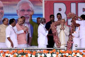 Prime Minister Narendra Modi  being garlanded at a public rally during  the  BJP National council meeting at Kozhikode on Saturday. Credit PTI