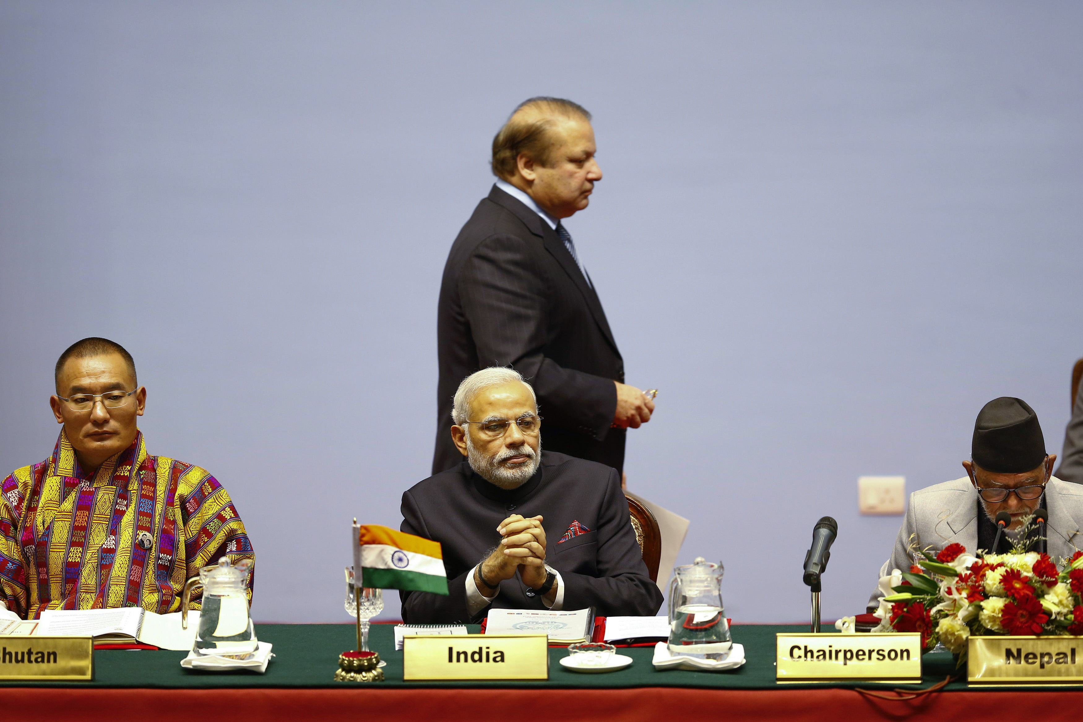 Pakistan's prime minister, Nawaz Sharif, walks past Indian prime minister Narendra Modi at the 2014 SAARC summit in Kathmandu. Credit: Reuters