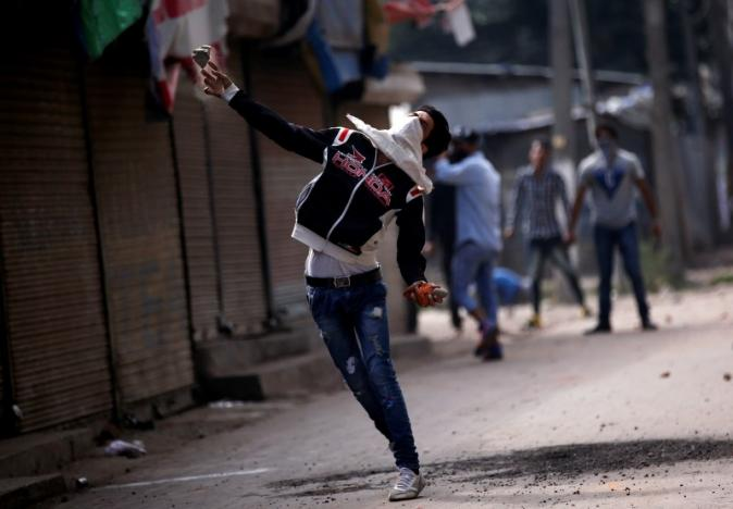 A protester throws a stone towards police during a protest against the recent killings in Kashmir, in Srinagar September 13, 2016. Credit: REUTERS/Danish Ismail