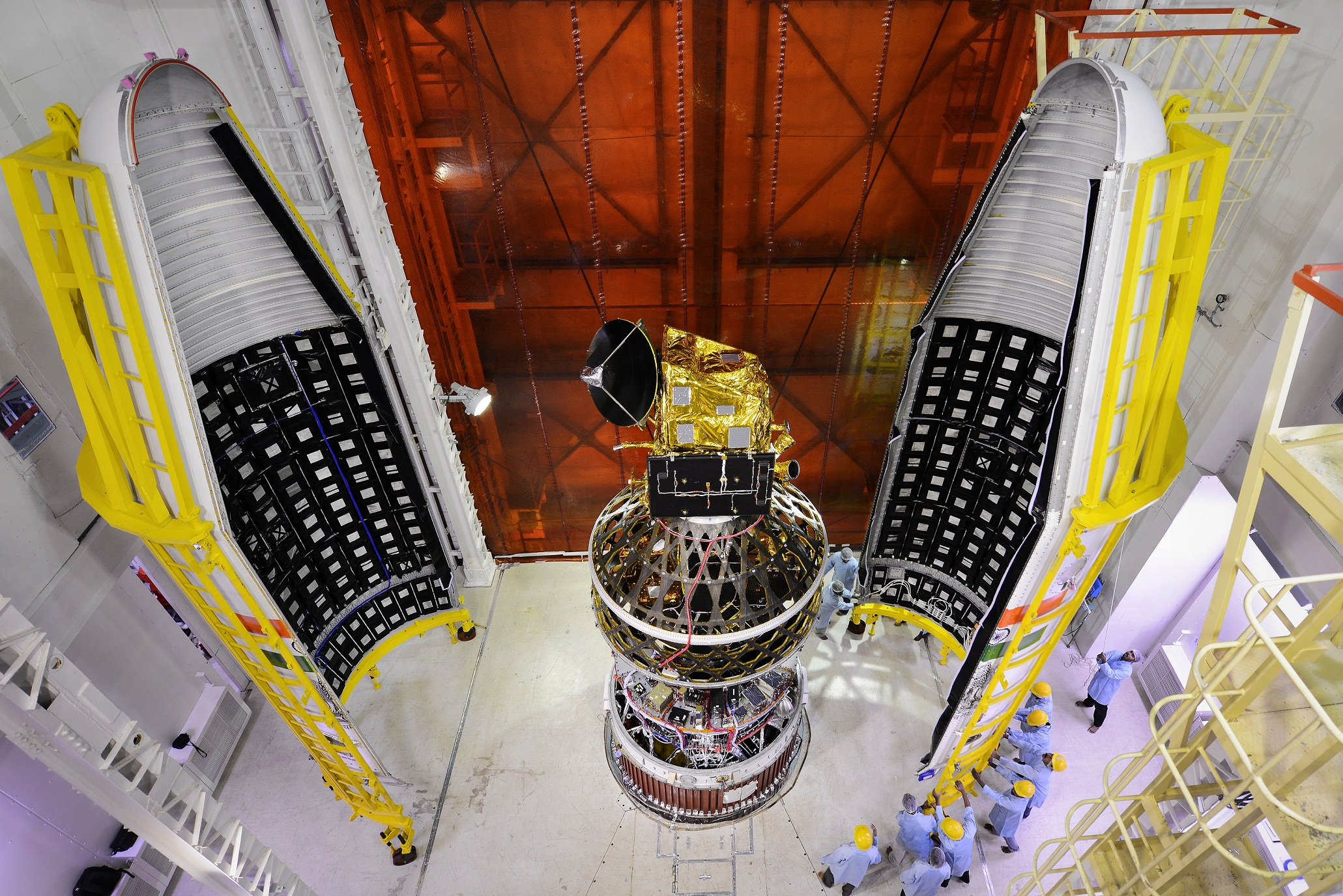 ScatSat-1 being integrated with the PSLV C-35. The payload fairing is to either side. Credit: ISRO