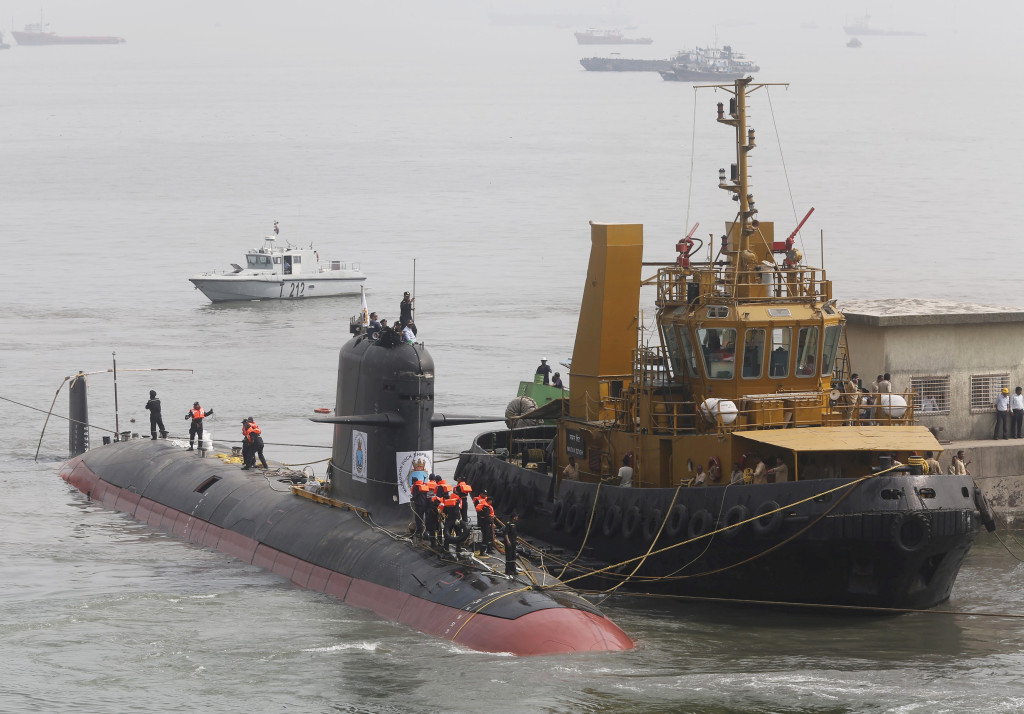 File photo of Indian Navy's Scorpene submarine INS Kalvari being escorted by tugboats as it arrives at Mazagon Docks Ltd, a naval vessel ship building yard, in Mumbai, India, October 29, 2015. REUTERS/Shailesh Andrade/Files - RTX2MRMT