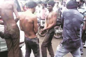 Screengrab of the Dalit men being hit with iron rods in Una