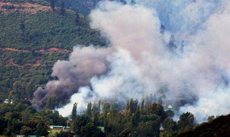 Smoke rises from the Army Brigade camp during a terror attack in Uri, Jammu and Kashmir. Credit: PTI