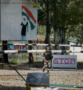 Uri: An army soldier in action inside the Army Brigade camp during a terror attack in Uri, Jammu and Kashmir on Sunday. Credit: PTI/ S. Irfan