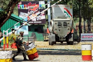 Army personnel in action inside the army brigade camp during a militant attack in Uri, Jammu and Kashmir on Sunday. Credit: PTI