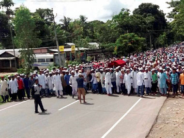 Villagers participating in a funeral procession for the two people killed in Kaziranga. Credit: PTI