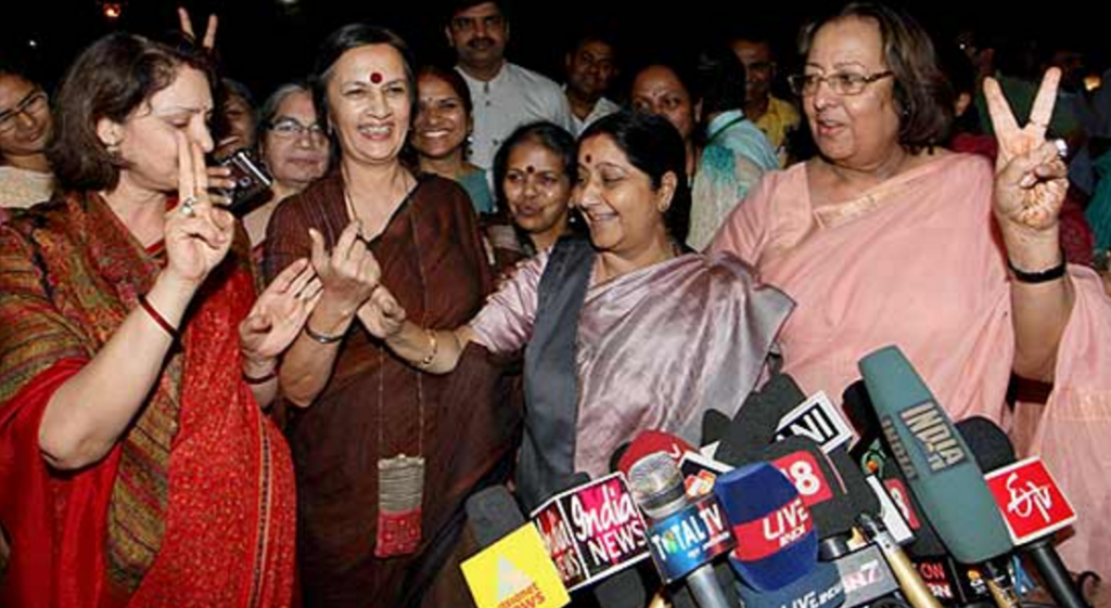 Then leader of the opposition in the Lok Sabha Sushma Swaraj with BJP leader Najma Heptullah and CPI(M) leader Brinda Karat celebrate the women's reservation Bill being passed in the Rajya Sabha. Credit: PTI/Files