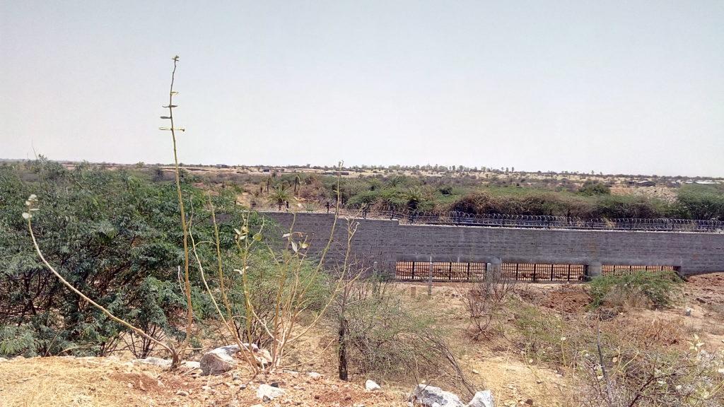 Bhabha Atomic Research Centre wall allows water through, but not animals. Credit: Gaurav Mendiratta