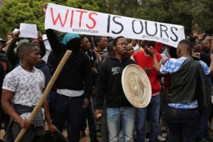 Students chant slogans during clashes with the South African police at Johannesburg's University of the Witwatersrand, South Africa, October 4, 2016. Credit: Reuters