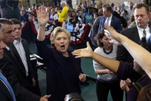 US Democratic presidential nominee Hillary Clinton waves to supporters after speaking at a voter registration rally at Wayne State University in Detroit, Michigan, October 10, 2016. Credit: Reuters