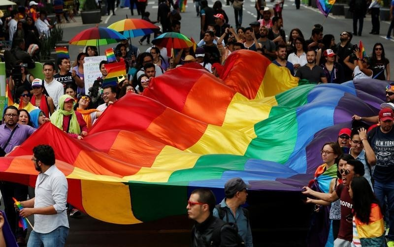 The LGBTI community wave a rainbow flag during a march in support of gay marriage, sexual and gender diversity in Mexico City, Mexico September 11, 2016. Credit: Reuters