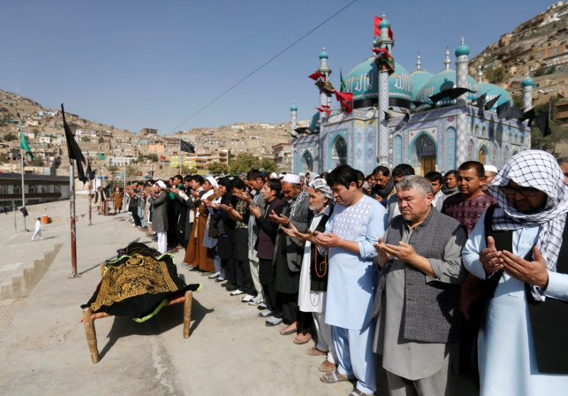 Afghan Shi'ite Muslims perform prayers at the funeral for one of the victims of Tuesday's attack at the Sakhi Shrine in Kabul, Afghanistan October 12, 2016. Credit: Reuters