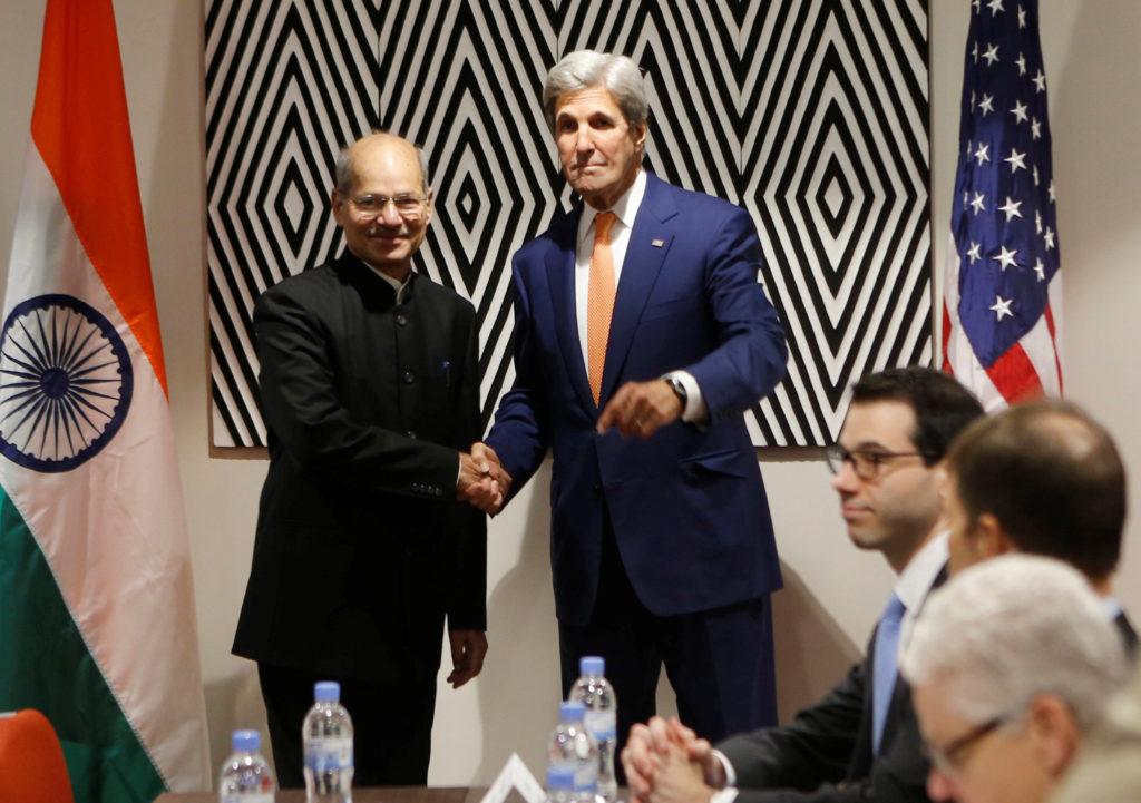 US secretary of state John Kerry shakes hands with India's minister of environment, forests and climate change Anil Madhav Dave before holding bilateral meeting to promote U.S. climate and environmental goals, at the meeting of the parties to the Montreal Protocol on the elimination of hydro fluorocarbons (HFCs) use in Rwanda's capital Kigali October 14, 2016. Credit: REUTERS/James Akena