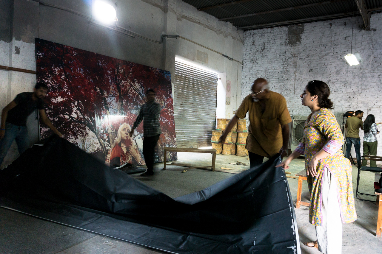 Curator Sadanand Menon supervises the unfolding of a larger than life image of Chandralekha