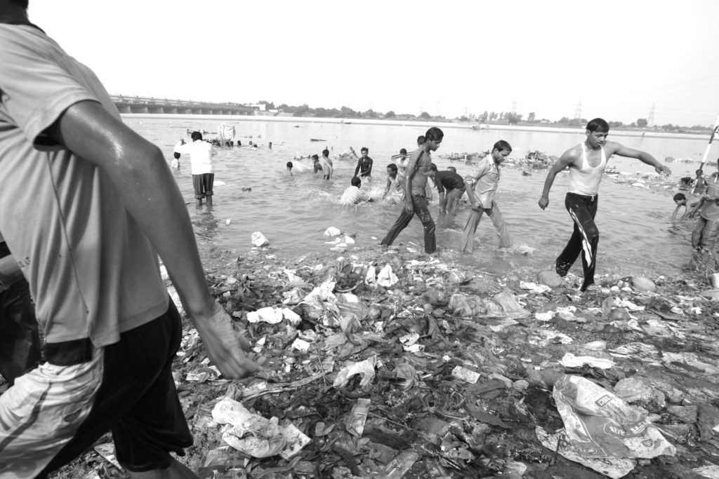 Plastic & other waste at the banks of River Yamuna accumulated during idol immersion. Despite warnings by environmental scientists and the imposition of fines, citizens ignore the hazardous consequences of idol immersion.