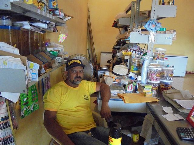 Carlos Damasceno in his store, which provides gas, food and other goods to the people of Vila Nova Teotônio. The town was built with 72 houses to resettle the villagers who lived along the Madeira River, in communities that were flooded by the Santo Antônio hydropower plant reservoir, in the northwest of Brazil. Credit: Mario Osava/IPS