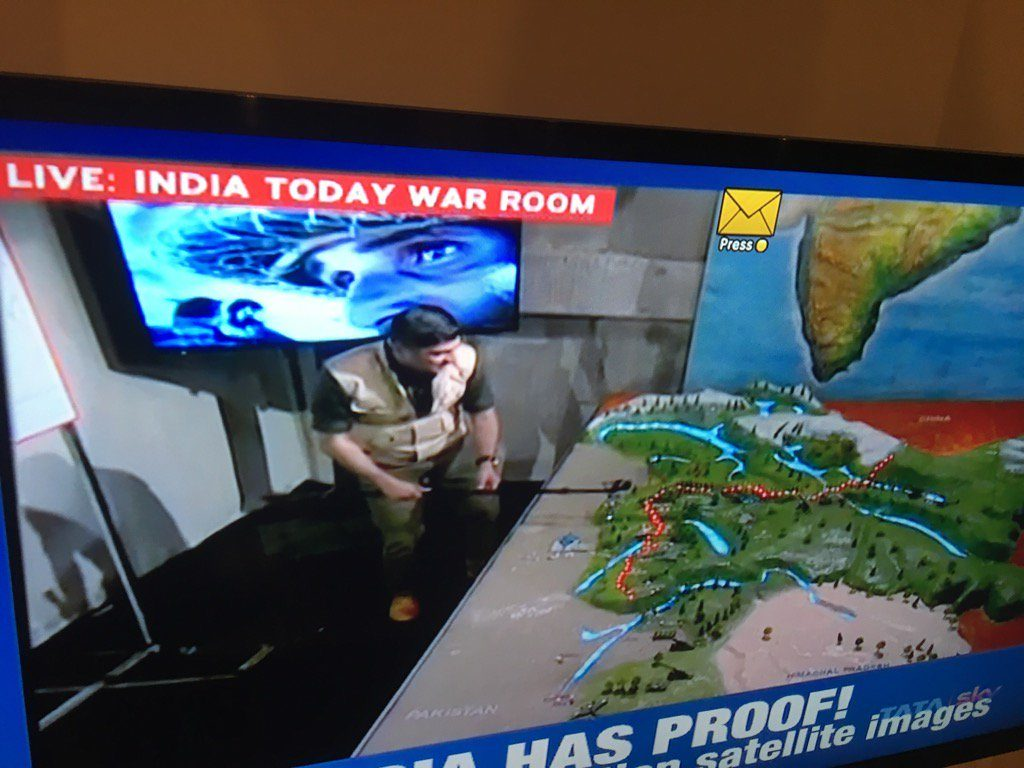 India Today TV anchor in faux military gear at his channel's 'war room'.