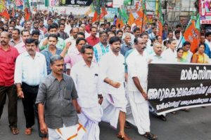 BJP members take out a protest march in Kozhikode as part of their statewide strike on Thursday to protest against the killing of a party worker in Kannur. Credit: PTI