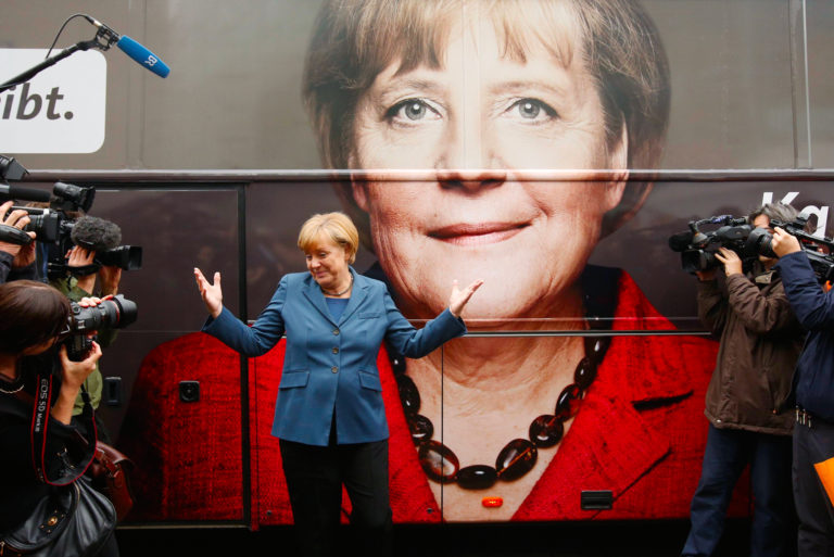 German Chancellor Angela Merkel and leader of the Christian Democratic Union party CDU stands in front of her election campaign tour bus before a CDU board meeting in Berlin. Credit:Fabrizio Bensch, Reuters/Files