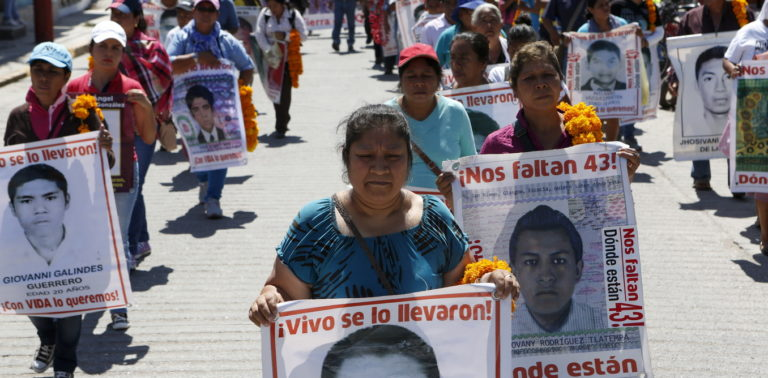 Relatives of the 43 missing students of the Ayotzinapa teacher training college march before receiving the final report on the disappearance of their sons by members of the Inter-American Commission on Human Rights (IACHR) in Tixtla, Guerrero state, Mexico, April 27, 2016. REUTERS/Ginnette Riquelme - RTX2BYRQ