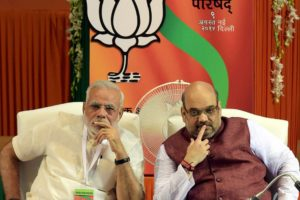 New Delhi: Prime Minister Narendra Modi and BJP President Amit Shah at the party's National Council meet in New Delhi on Saturday. PTI Photo by Manvender Vashist(PTI8_9_2014_000145A)