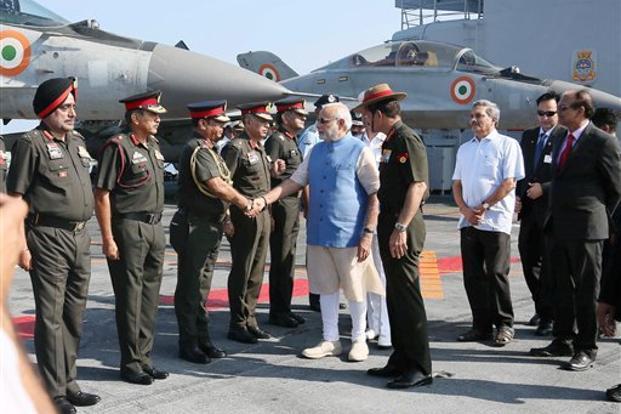 Prime Minister Narendra Modi with defence minister Manohar Parrikar and army chief Dalbir Singh Suhag meeting top army commanders at INS Vikramaditya in Kochi, Kerala. Credit: PTI
