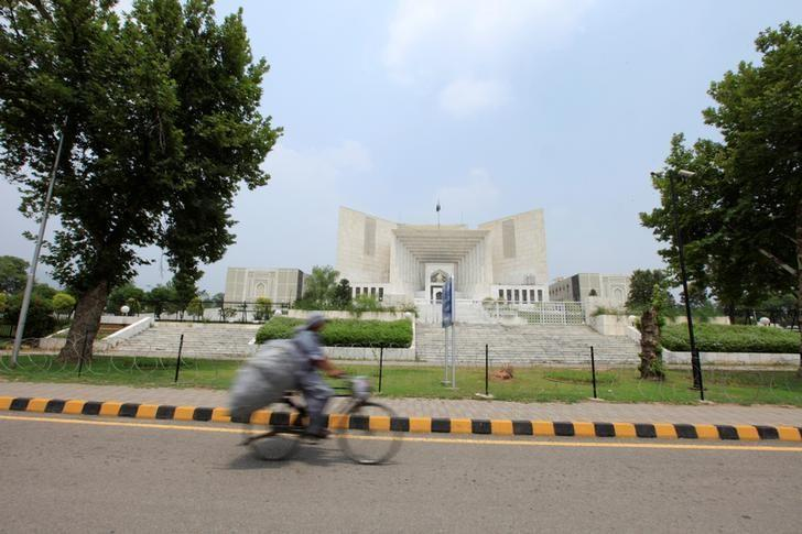 A man rides a bicycle past the Supreme Court building in Islamabad, Pakistan, June 27, 2016. Credit: Reuters/Faisal Mahmood/Files