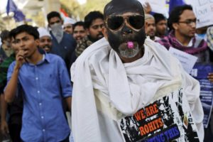 A demonstrator blows a whistle as others shout slogans during a protest march in New Delhi, India, February 23, 2016. Hundreds of the demonstrators on Tuesday took out a protest to express solidarity for Rohit Vemula, a low-caste student of the University of Hyderabad who was found hanging at a hostel last month, and were also demanding the release of Kanhaiya Kumar, a Jawaharlal Nehru University (JNU) student union leader accused of sedition. Credit: Anindito Mukherjee, Reuters/Files