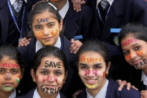 School girls welcoming the new year 2013 with a message 'save girls' in Gurgaon. Credit: PTI/Files