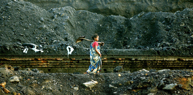 An Indian coalmine worker walks along Stilwell Road on her way home after a day's work in Lido town, about 600 km (373 miles) from Guwahati, a major city in the northeastern Indian state of Assam, August 19, 2005. Sixty years ago, that road named after U.S. General Joe Stilwell provided a vital lifeline to relieve China's besieged army as it fought Japanese occupation. Today much of Stilwell Road lies disused and overgrown, in parts little more than a jungle track. But it is slowly becoming a symbol of hope, as Beijing and New Delhi repair relations and talk of reopening the road for trade, perhaps as part of a pan-Asian highway. Picture taken August 19, 2005. To match feature India-China-Stilwell. Credit: Adnan Abida, Reuters/ Files