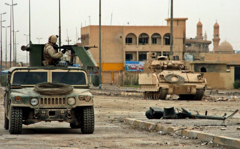 U.S. Marine patrol in the Iraqi western war-torn city of Fallujah. Nov. 27, 2004. Credit: Reuters