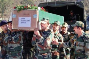 File photo from 2013 of Indian army soldiers carrying a coffin containing the  body of a soldier allegedly killed and mutilated by Pakistani forces. PTI