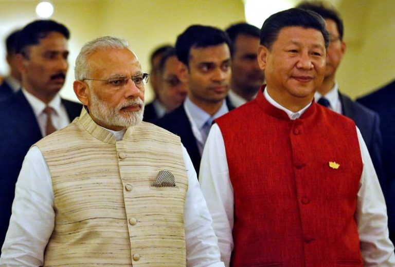 Indian Prime Minister Narendra Modi (L) and Chinese President Xi Jinping arrive for a photo opportunity ahead of BRICS (Brazil, Russia, India, China and South Africa) Summit in Benaulim, in Goa, India, October 15, 2016. Credit:Danish Siddiqui/Reuters/Files