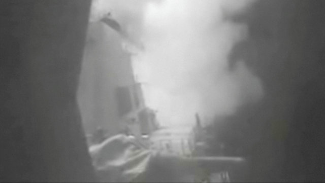 A still image from video released October 13, 2016 shows US military launching cruise missile strikes from US Navy destroyer USS Nitze to knock out three coastal radar sites in areas of Yemen controlled by Houthi forces. Credit: Reuters