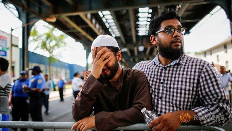 A man cries as community members take part in a protest to demand stop hate crime after the funeral service of Imam Maulama Akonjee and Thara Uddin in Queens in August. Credit: Reuters/Eduardo Munoz