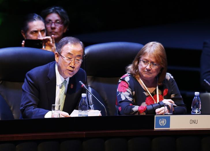Ban Ki-moon (L) addresses the audience next to Susana Malcorra, United Nations Chef de Cabinet to the Executive Office, during a session of the Community of Latin American and Caribbean States (CELAC) summit in Havana in this file January 28, 2014 photo. Credit: Reuters/Enrique De La Osa
