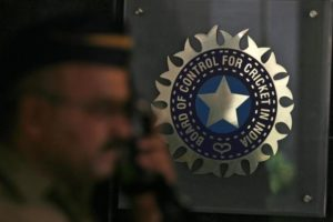 A policeman walks past a logo of the Board of Control for Cricket in India (BCCI) in Mumbai April 26, 2010. REUTERS/Arko Datta/Files