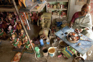 An artisan paints the idols of Hindu gods and goddesses at a workshop in Mumbai. The five states with the largest proportion of literate women –Tamil Nadu, Kerala, Andhra Pradesh, West Bengal and Maharashtra–account for 53% of all business establishments owned by women nationwide. Credit: Sima Dubey/Reuters