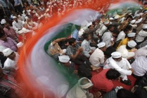 Supporters of Anna Hazare waved national flags during an anti-corruption protest in New Delhi, March 25. Credit: Adnan Abidi/Reuters/Files