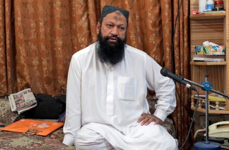 Leader of the Lashkar-e-Jhangvi (LeJ) Malik Ishaq speaks during an interview with Reuters at his home in Rahim Yar Khan in southern Punjab province October 9, 2012. Credit: Reuters/Mian Khursheed/Files