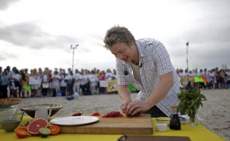 Jamie Oliver cooking in 2008. Credit: Reuters /Eric Thayer