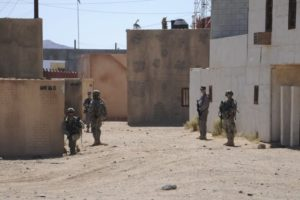 Afghan Uniform Police and soldiers from the US Army 4th Brigade Combat Team provide 360-degree security outside a compound during training at National Training Center at Ft. Irwin, California, US on September 18, 2011. Courtesy Austin Pritchard/US Army/Handout via Reuters/Files